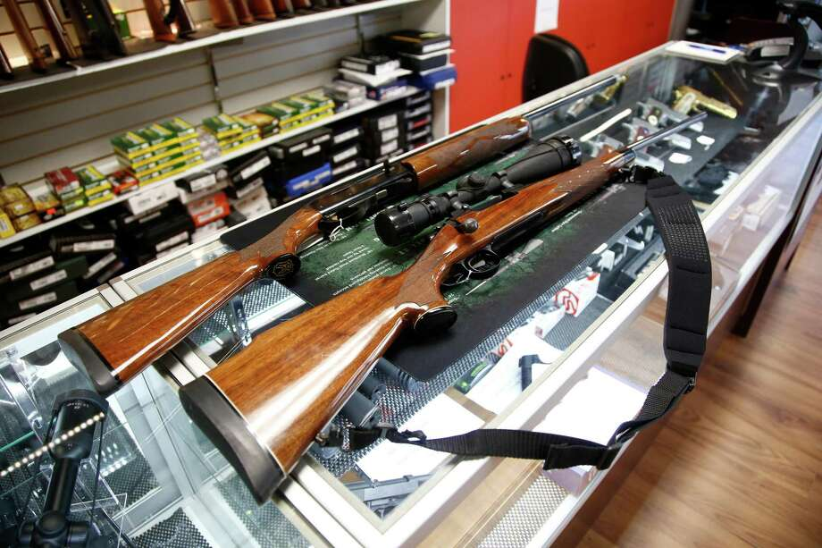 A Remington 700 hunting rifle and a Remington 1100 shotgun are seen for sale at Atlantic Outdoors gun shop Monday in Stokesdale, N.C. Founded in 1816, Remington is one of America's oldest gun and ammunition manufacturers which now has filed for Chapter 11 bankruptcy protection partially due to an estimated $950 million in debt. Photo: Brian Blanco, Stringer / Getty Images / 2018 Getty Images