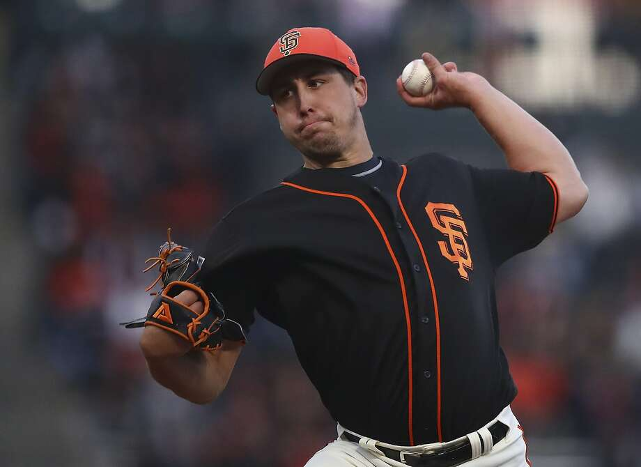 San Francisco Giants' Derek Holland works against the Oakland Athletics during the first inning of a spring training baseball game on Monday, March 26, 2018, in San Francisco. (AP Photo/Ben Margot) Photo: Ben Margot, Associated Press
