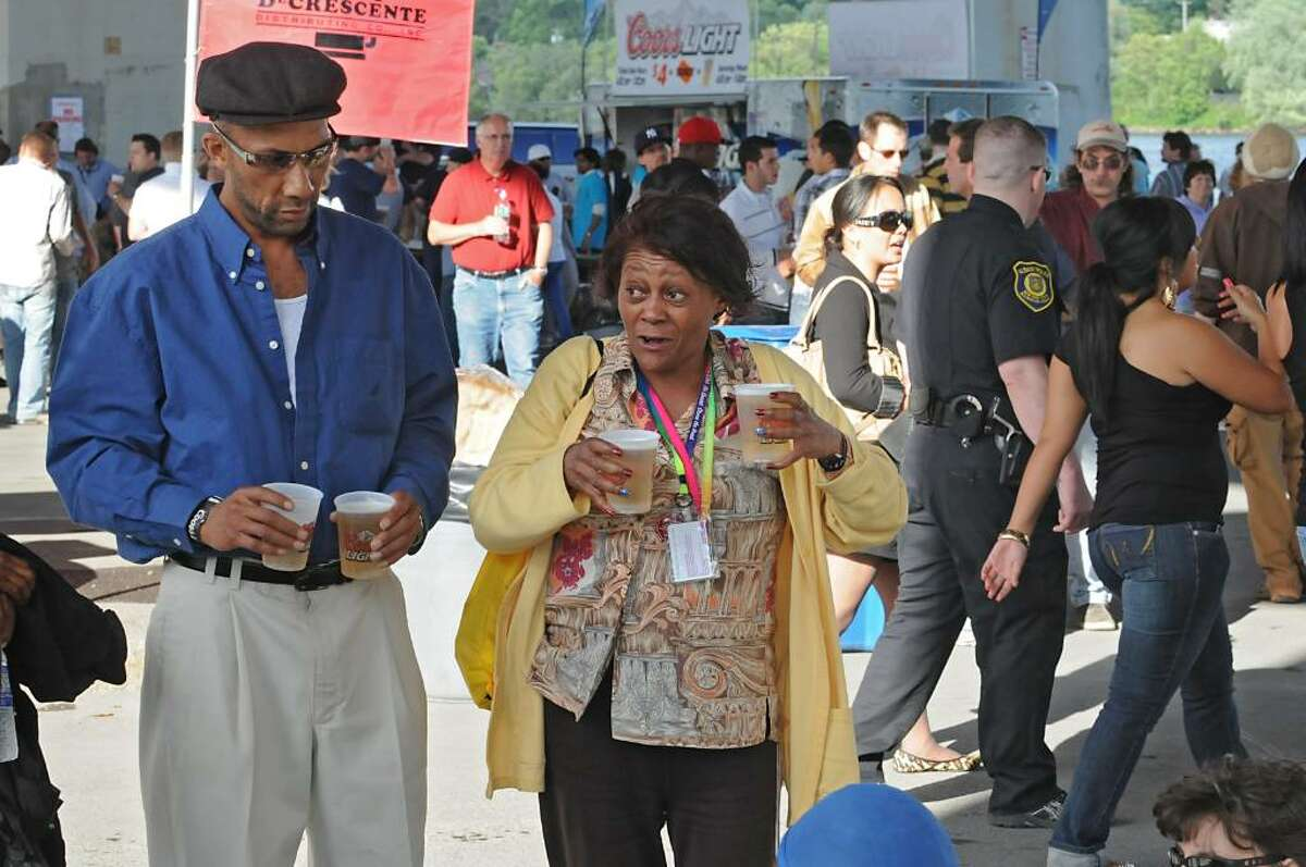 People buy beer at Alive at Five featuring Chubby Checker at the Corning Preserve rain location under I-787 in Albany, NY on June 10, 2010. (Lori Van Buren / Times Union)