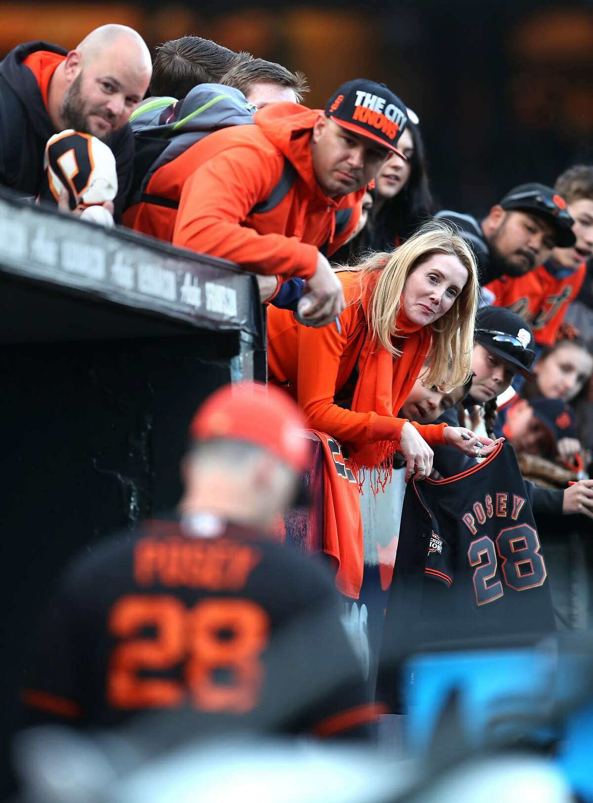 San Francisco Giants' fans try to get Buster Posey's autograph before Giants play Oakland Athletics during Bay Bridge Series game at AT&T Park in San Francisco, Calif., on Monday, March 26, 2018.