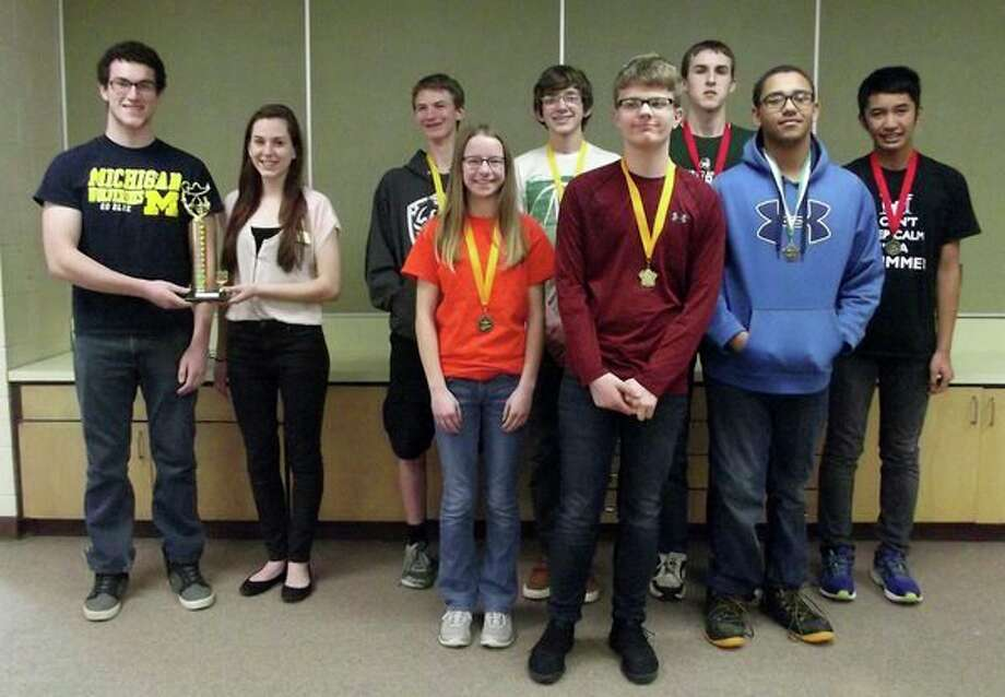 The top 10 students from the Tournament of Champions are (from left with trophy): Andrew Gilbert and Macy Knoblock, both of Ubly; (From row from left): Hannah Emerick, of Harbor Beach, Jacob Shemka, of Bad Axe, and Raymond Shavers, Brown City; (Back row from left): Kevin Doerr, of Bad Axe, Gage Larson, of Sandusky, Logan Childers and Raymond Shavers, bother of Brown City. (Submitted photo)