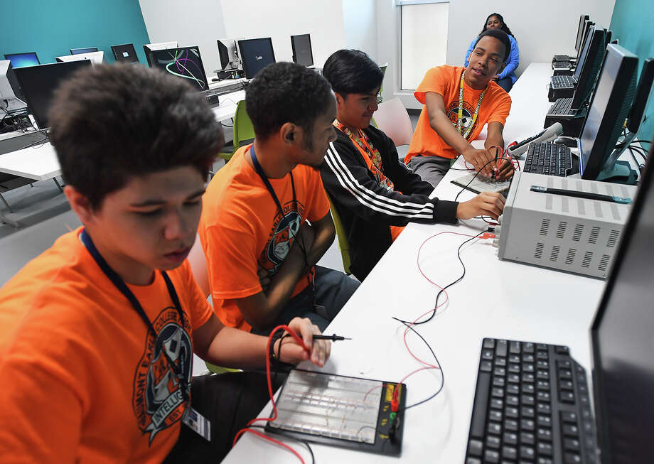 Beaumont Independent School District students, Austin Kotlarich, Colin Booker, Alberto Jimenez and Logan Batiste, from left, learn about process operating at Lamar Institute of Technology on Monday. Photo taken Monday, March 26, 2018 Guiseppe Barranco/The Enterprise Photo: Guiseppe Barranco, Photo Editor / Guiseppe Barranco ©
