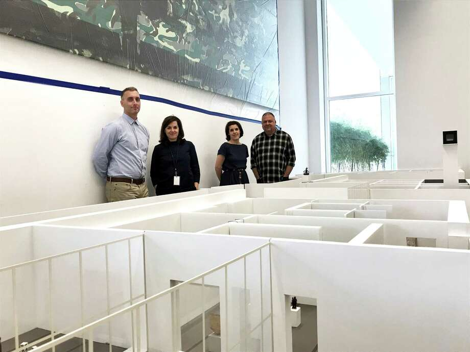 Menil Collection curators Paul Davis, from left, Michelle White and Clare Elliott and exhibition designer Brooke Stroud on Feb. 28 in the museum's model room, where they are planning a major redesign of gallery spaces Photo: Molly Glentzer, Houston Chronicle