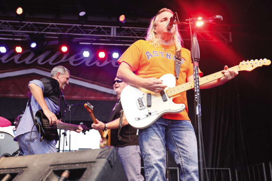 Bayou Roux performs on the Cajun Stage during the Conroe Cajun Catfish Festival in 2015. The group returns to the area again on April 15 to play at Bernhardt Winery's Concert on the Lawn. Photo: Michael Minasi, Photographer / Conroe Courier
