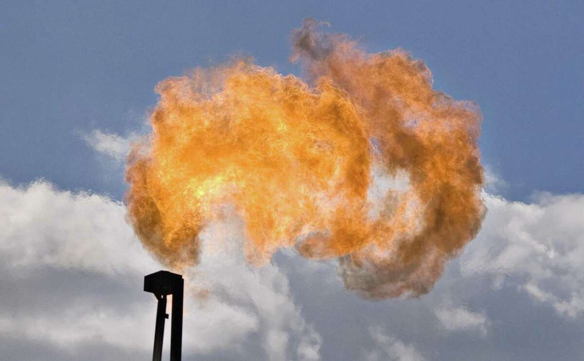 Natural gas is flared at the Handy Gas Unit #1, a Pioneer Natural Resources well, in Karnes County, Texas, U.S., on Tuesday, June 22, 2010. Dallas-based Pioneer Natural Resources is selling part of its Eagle Ford Shale acreage for $102 million.