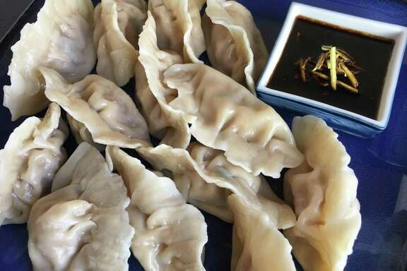 Pork & Napa Cabbage Water Dumplings are a specialty of Beijing in northern China.