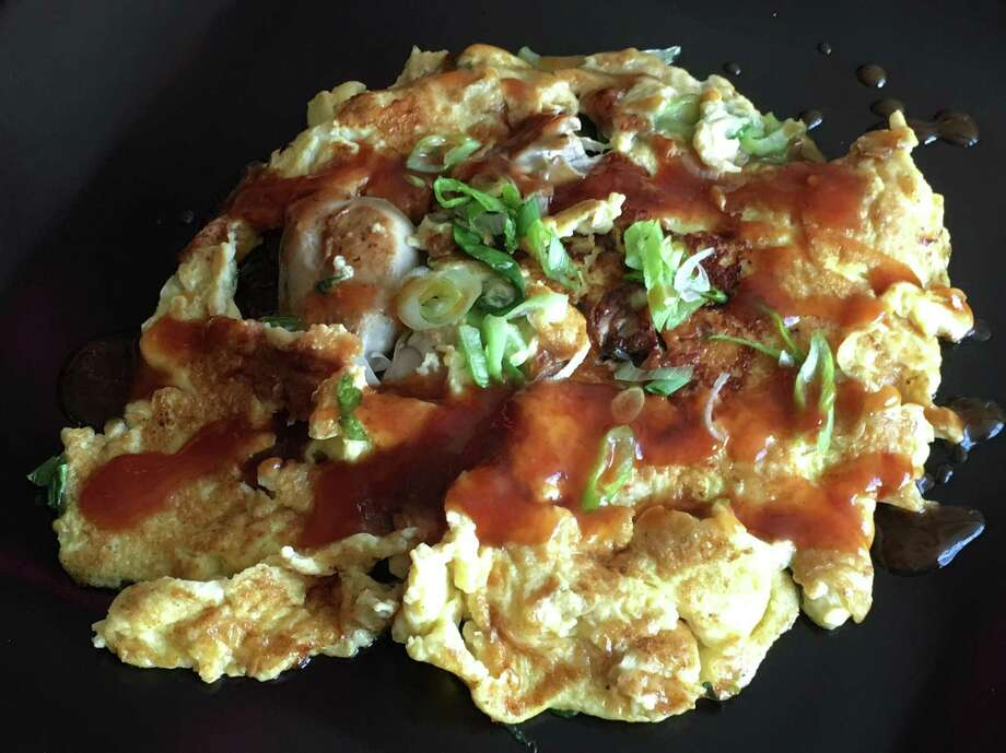 """This Oyster Omelet recipe is adapted from """"The Food of Taiwan: Recipes from the Beautiful Island"""" by Cathy Erway (Houghton Mifflin Harcourt; $30). According to Erway, this dish is rooted in Fujian cuisine, but is especially popular in Taiwan both in home kitchens and night market stalls. The sweet potato starch slurry that is added to the omelet during cooking, along with the oysters, gives the dish a soft and gelatinous texture. Photo: Sarah Fritsche / Sarah Fritsche / The Chronicle / SFC"""