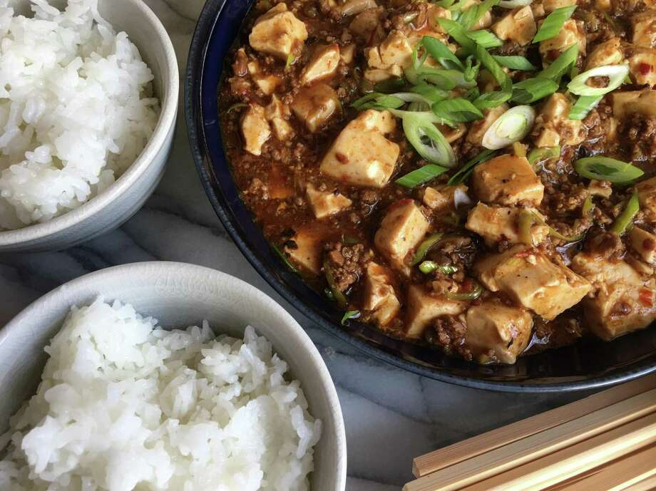 "This recipe for Mapo Doufu is adapted from ""All Under Heaven: Recipes from the 35 Cuisines of China"" by Carolyn Phillips (Ten Speed Press; $40). In her book, Phillips writes that this immensely popular Sichuanese dish was invented over 100 years ago by a pockmarked woman (mapo) named Chen at her food stand outside the northern gates of Chengdu. Photo: Sarah Fritsche / SFC / SFC"