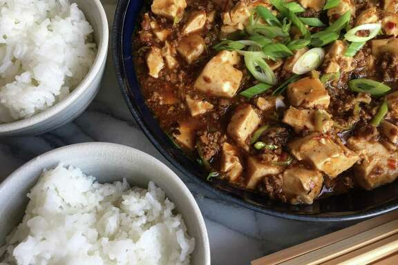 "This recipe for Mapo Doufu is adapted from ""All Under Heaven: Recipes from the 35 Cuisines of China"" by Carolyn Phillips (Ten Speed Press; $40). In her book, Phillips writes that this immensely popular Sichuanese dish was invented over 100 years ago by a pockmarked woman (mapo) named Chen at her food stand outside the northern gates of Chengdu."