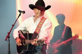 In this handout photo provided by The Country Rising Fund of The Community Foundation of Middle Tennessee, singer-songwriter George Strait performs onstage for the Country Rising Benefit Concert at Bridgestone Arena on November 12, 2017 in Nashville, Tennessee.