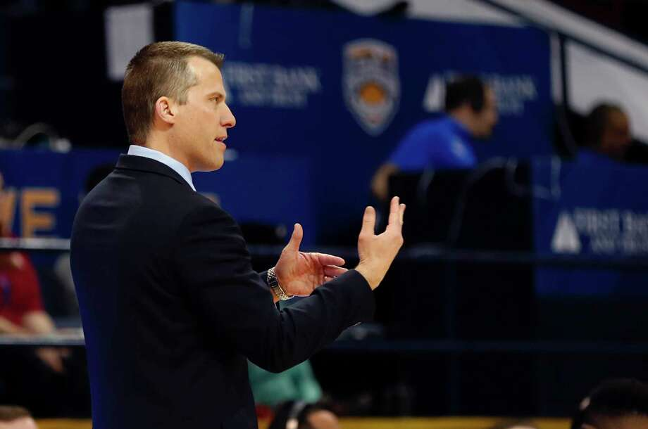 Texas-Arlington head coach Scott Cross calls out from the bench in the first half of the Sun Belt Conference NCAA college basketball championship game against Georgia State in New Orleans, Sunday, March 11, 2018. Georgia State won 74-61. (AP Photo/Gerald Herbert) Photo: Gerald Herbert, Associated Press / Copyright 2018 The Associated Press. All rights reserved.