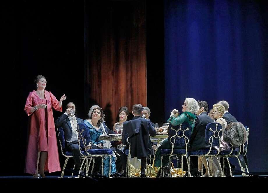 "Amanda Echalaz (left) and the cast of Thomas Adès' ""The Exterminating Angel"" at the Metropolitan Opera. Photo: Ken Howard/Metropolitan Opera"
