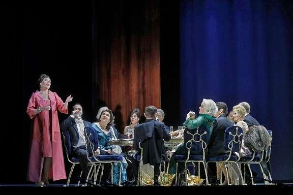 "Amanda Echalaz (l.) and the cast of Thomas Ad�s' ""The Exterminating Angel"" at the Metropolitan Opera"