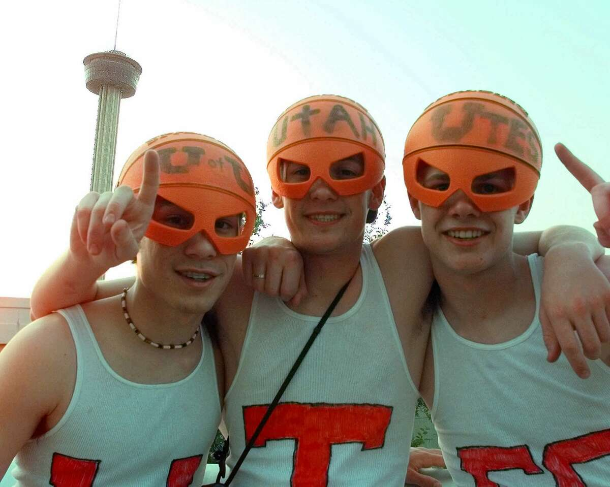 Utah basketball fans Matt Faulkner, 17, left, Dallin Johnston, 16, and Justin Johnston, right, all from Salt Lake City, Utah, arrive prepared for the NCAA Men's Final Four Championship game at the Alamodome in San Antonio on March 30, 1998. The Tower of the America's, built for the 1968 World's Fair, appears behind them.
