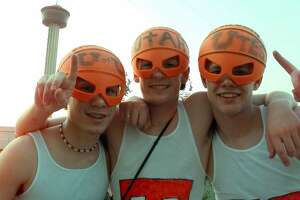 Utah basketball fans Matt Faulkner, 17, left, Dallin Johnston, 16, and Justin Johnston, right, all from Salt Lake City, Utah, arrive prepared for the  NCAA Men's Final Four Championship game at the Alamodome in San Antonio, Monday, March 30, 1998.  The Tower of the America's, built for the 1968 World's Fair, appears behind them.