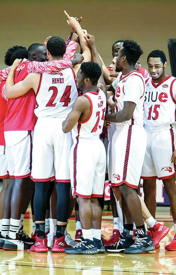 Members of the SIUE men's basketball team celebrate following a game earlier this season. Tuesday, the team was named the winner of the Ohio Valley Conference Sportsmanship Award. Photo: SIUE Athletics