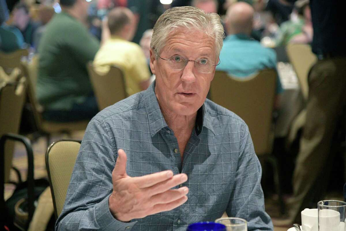 Seattle Seahawks head football coach Pete Carroll answers a question from a reporter at the coaches breakfast during the NFL owners meetings, Tuesday, March 27, 2018 in Orlando, Fla. (Phelan M. Ebenhack/AP Images for NFL)