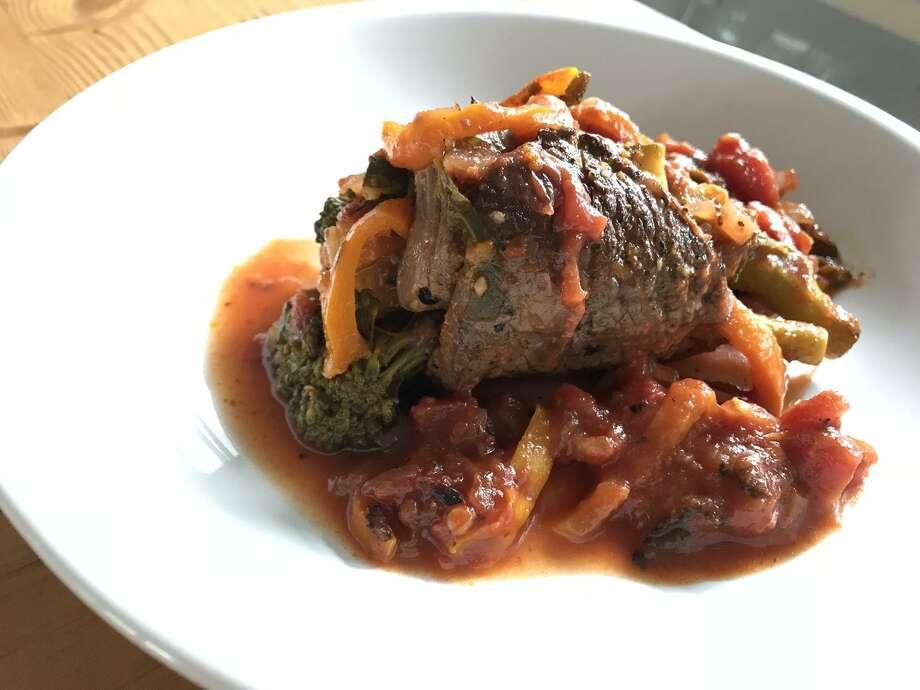Tomato-braised Broccolini-stuffed Beef Rolls Photo: Emily Spicer / San Antonio Express-News