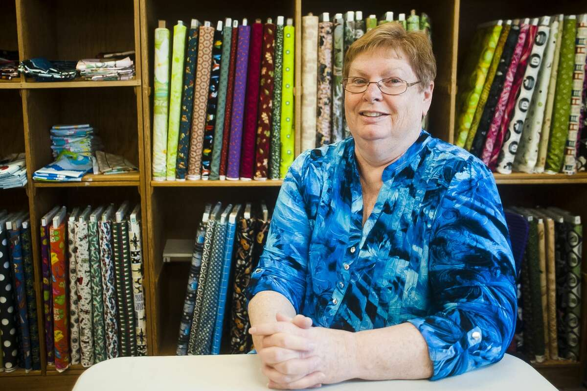 Local quilter Kathy Mallory poses for a portrait inside Material Mart on March 27, 2018. (Katy Kildee/kkildee@mdn.net)
