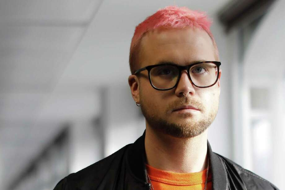 "Canadian data analytics expert and whistle-blower, Christopher Wylie poses for photographs outside a press conference in London on March 26, 2018. Instantly recognisable with his pink hair and nose ring, Christopher Wylie claims to have helped create data analysis company Cambridge Analytica before turning whistleblower and becoming ""the face"" of the crisis engulfing Facebook. Photo: TOLGA AKMEN /AFP /Getty Images / AFP or licensors"