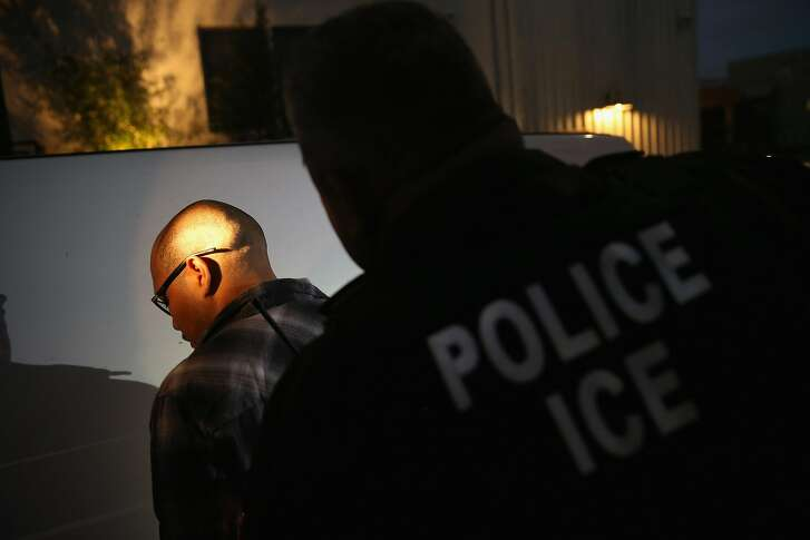 NORTHRIDGE, CA - OCTOBER 14:  A man is detained by Immigration and Customs Enforcement (ICE), agents early on October 14, 2015 in Los Angeles, California. ICE agents said the undocumented immigrant was a convicted criminal and gang member who had previously been deported to Mexico and would be again. ICE builds deportation cases against thousands of undocumented immigrants, most of whom, they say, have criminal records. The number of ICE detentions and deportations from California has dropped since the state passed the Trust Act in October 2013, which set limits on California law enforcement cooperation with federal immigration authorities.  (Photo by John Moore/Getty Images)
