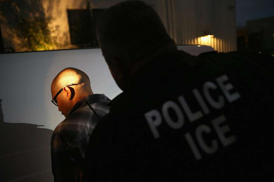A federal Immigration and Customs Enforcement agent detains a man in Los Angeles in 2015. Photo: John Moore / Getty Images