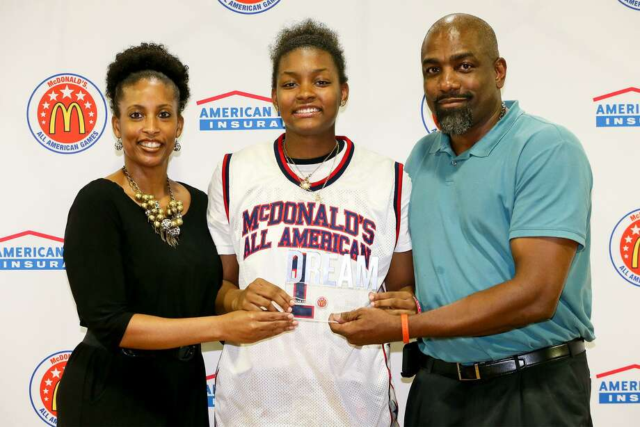 East Central's NaLyssa Smith with her parents Rodney and Nikki Smith after receiving her McDonalds All-American jersey during a ceremony in the school's gym on Tuesday, Feb. 20, 2018. Smith will be playing for the West team in the 2018 McDonalds All-American Games at Philips Arena in Atlanta on March 28.   MARVIN PFEIFFER/mpfeiffer@express-news.net Photo: Marvin Pfeiffer, Staff / San Antonio Express-News / Express-News 2018
