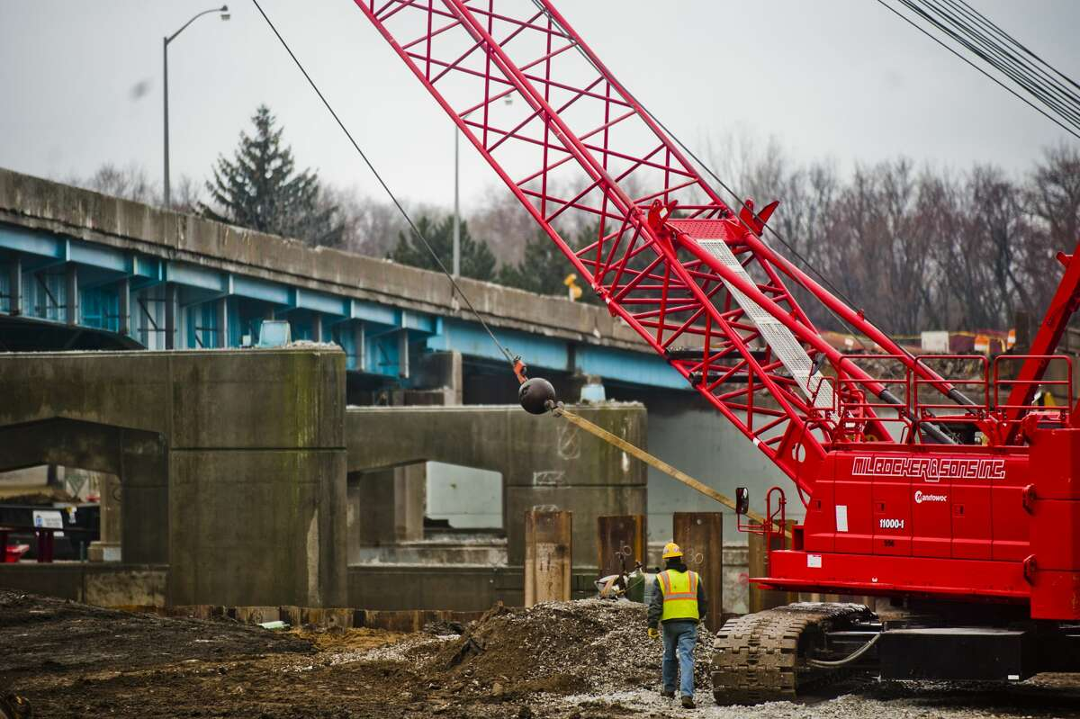 The entire westbound side of the M-20 bridge is gone as construction work continues on Tuesday, March 27, 2018. Traffic has been shifted over to allow for travelers to use the bridge in both directions during the construction. (Katy Kildee/kkildee@mdn.net)