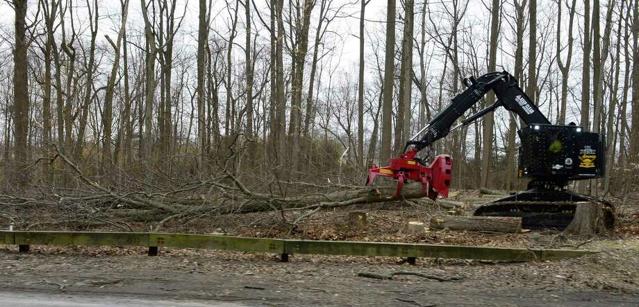 A crew from the Connecticut Department of Transportation clear trees along the Northbound Merritt Parkway at exit #31 for North Street in Greenwich, Conn. on Tuesday, March 27, 2018. Photo: Matthew Brown, Hearst Connecticut Media / Stamford Advocate