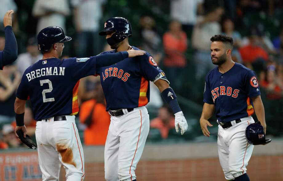 Houston Astros shortstop Carlos Correa (1) celebrates his grand slam home run with Alex Bregman (2) and Jose Altuve (27) during the first inning of an MLB exhibition game at Minute Maid Park, Tuesday, March 27, 2018, in Houston. Photo: Karen Warren, Houston Chronicle / © 2018 Houston Chronicle
