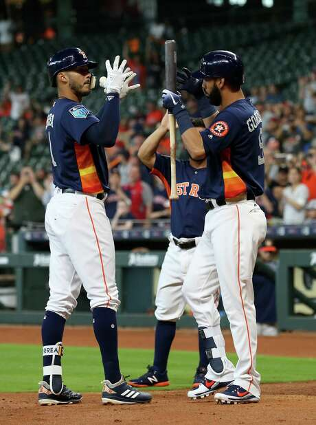 Houston Astros shortstop Carlos Correa (1) celebrates his grand slam home run with Houston Astros left fielder Marwin Gonzalez (9) during the first inning of an MLB exhibition game against the Milwaukee Brewers at Minute Maid Park Tuesday, March 27, 2018, in Houston. Photo: Godofredo A. Vasquez, Houston Chronicle / Godofredo A. Vasquez