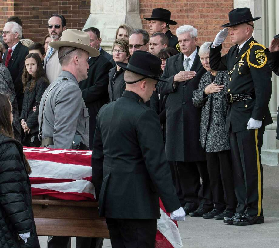 Pall bearers carry the casket carrying the remains of former Albany County Sheriff past his wife, Pat, second from right,  to St. Mary's Church before his funeral ceremony Tuesday March 27, 2018 in Albany, N.Y.  (Skip Dickstein/Times Union) Photo: SKIP DICKSTEIN, Albany Times Union / 20043312A