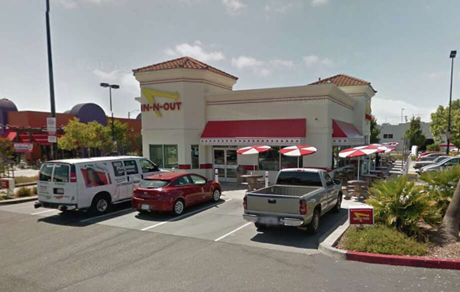 A Google Street View image shows the In-N-Out, near the Oakland Coliseum, where a Michigan couple's engagement ring was stolen on Monday, Mrach 27, 2018. A sign posted in the parking lot warns drivers not to leave valuables in their vehicles. Photo: Google Street View