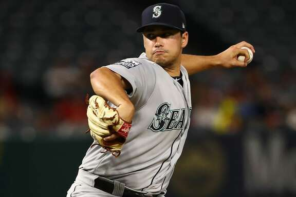 ANAHEIM, CA - SEPTEMBER 29: Pitcher Marco Gonzales #32 of the Seattle Mariners pitches during the first inning of the MLB game against the Los Angeles Angels of Anaheim at Angel Stadium of Anaheim on September 29, 2017 in Anaheim, California.  (Photo by Victor Decolongon/Getty Images)