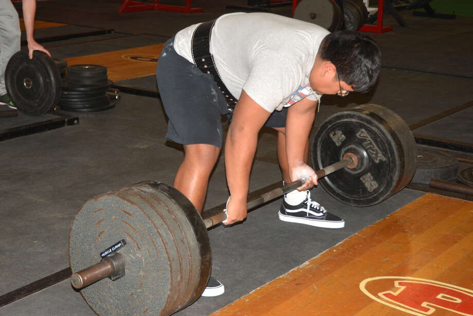 Plainview's Octavius Vera prepares to execute a dead lift during a practice leading up to the state meet. The Bulldog senior finished sixth in the 275-pound weight class at the state meet in Abilene. Photo: Skip Leon/Plainview Herald