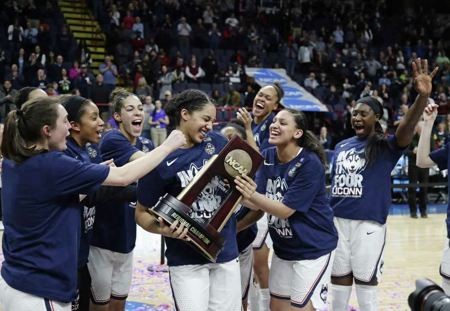 UConn's Gabby Williams (15), center, celebrates with teammates after beating South Carolina 94-65 in the Albany Regional final on Monday in Albany, N.Y. Williams was named the regional's most outstanding player. Photo: Frank Franklin II / Associated Press / Copyright 2018 The Associated Press. All rights reserved.