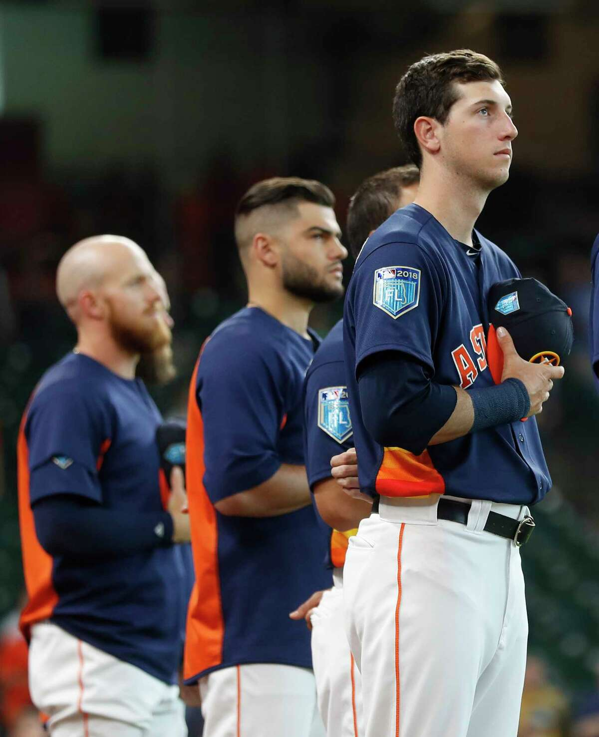 Houston Astros Kyle Tucker during the National Anthem before the first inning of an MLB exhibition game at Minute Maid Park, Tuesday, March 27, 2018, in Houston.