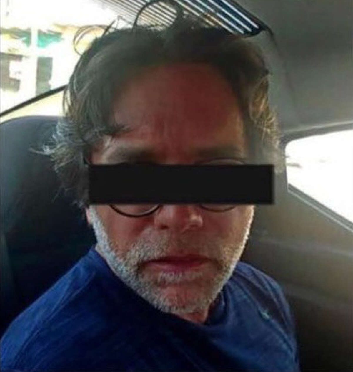 Keith Raniere in a police car after being arrested Sunday, March 15, 2018, in Mexico.(Photo courtesy Frank Parlato/ArtVoice)