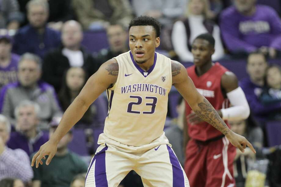 SEATTLE, WA - JANUARY 01: Washington's #23 Carlos Johnson sets up on defense against Washington State.  Washington State won 79-74 over Washington at Alaska Airlines Arena in Seattle, WA.  (Photo by Jesse Beals/Icon Sportswire via Getty Images) Photo: Icon Sportswire/Icon Sportswire Via Getty Images