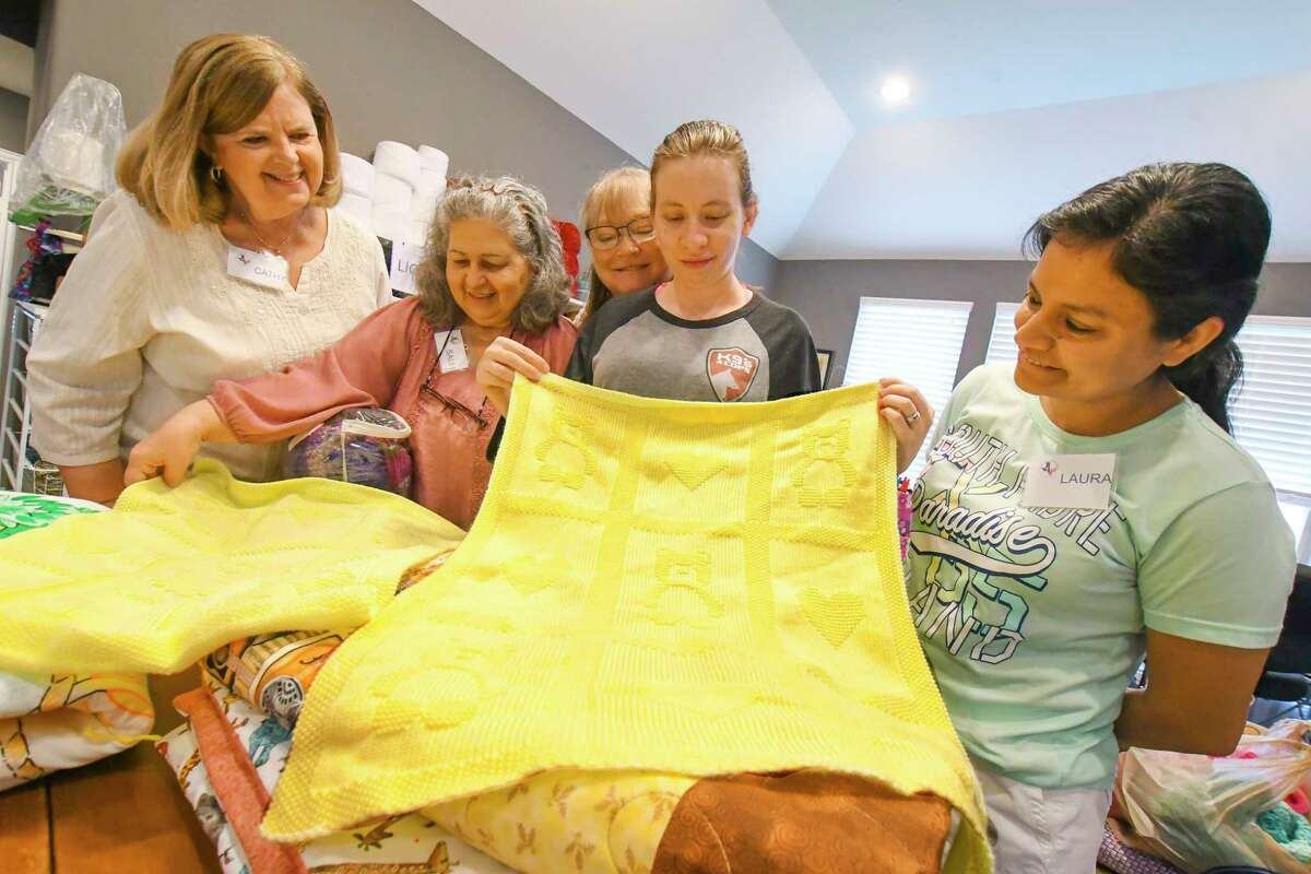 Cathy Travland, left, Lisandra Mauras, Pamela Zwecker, Beth Zachau and Laura Brunson are members of the Helping Hands Ladies of Cypress, a nonprofit organization, that knits and crochets hats for the homeless, chemo patients, newborns, troops, and first responders. The group also makes scarves and baby blankets and quilts for those in hospice and the homeles. Helping Hands Ladies of Cypress make hats and quilts for the homeless, blankets for babies at Willowbrook Methodist hospital, quilts for patients at Ronald McDonald house, and Hero Hats for individuals in recognition of community leadership.