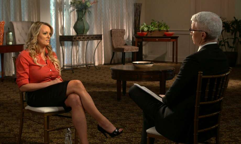 "This image released by CBS News shows Stormy Daniels, left, during an interview with Anderson Cooper which aired on Sunday on ""60 Minutes."" The damage here is not that the president had an affair, but that Daniels, a porn star, is simply more credible than the president who denies the affair took place. Photo: /Associated Press / CBS News"