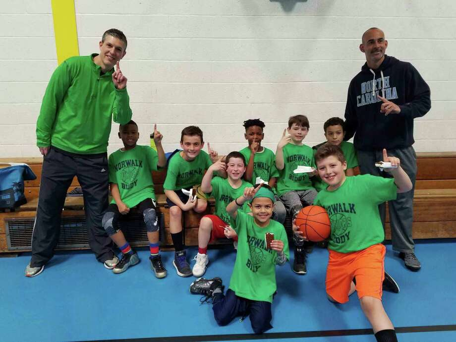 Miami won the Norwalk Junior Biddy League championships. From left: coach Chris DeLuca, CJ Prescott, Justin Beazley, Josh Todd, Calvin Talbert, Kevin Gordon, Gabriele Pote, Alex DeLuca, Nathan Staufer and coach Ian Beazley. Not pictured: Ryan Roselle. Photo: Contributed Photo