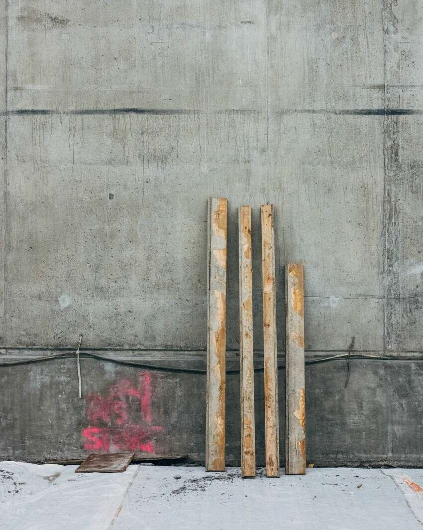 Concrete scraping planks are piled near recently poured concrete in the SR-99 tunnel, Tuesday, March 27, 2018. (GRANT HINDSLEY, seattlepi.com)
