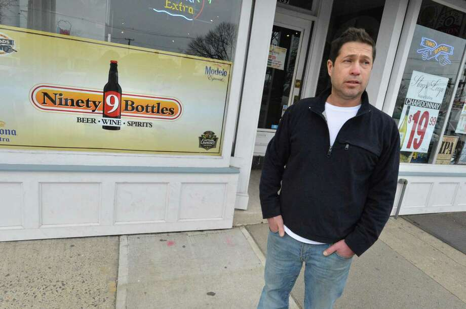 Rich Dunn, Manager at Ninety 9 Bottles liquor store talks about the parking lot situation where his store is located in Liberty Square on Tuesday March 27, 2018 in Norwalk Conn.The Norwalk Parking Authority has agreed to maintain and improve the city owned Liberty Square parking lot Photo: Alex Von Kleydorff / Hearst Connecticut Media / Norwalk Hour