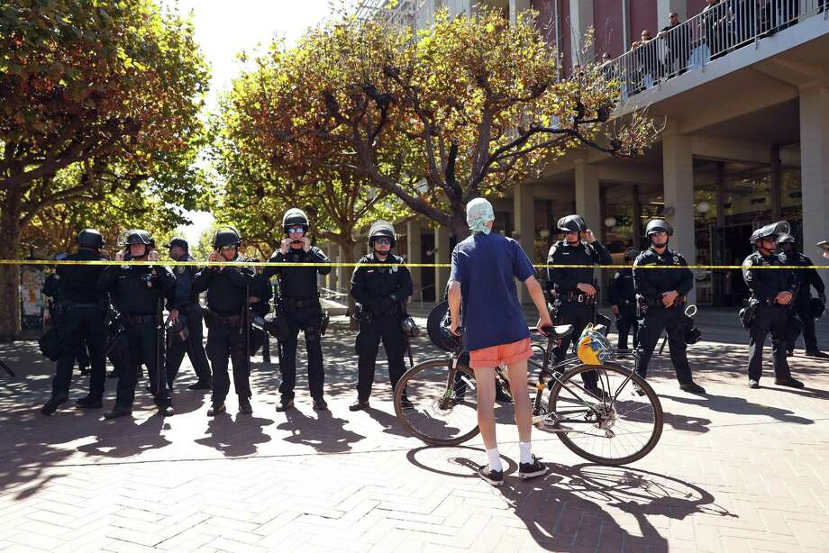 "California State University Police limit access to Sproul Plaza during another day of protests in wake of the cancellation of ""Free Speech Week"" on the Berkeley campus of the University of California in Berkeley, Calif., in September. Photo: Scott Strazzante /The Chronicle / San Francisco Chronicle"