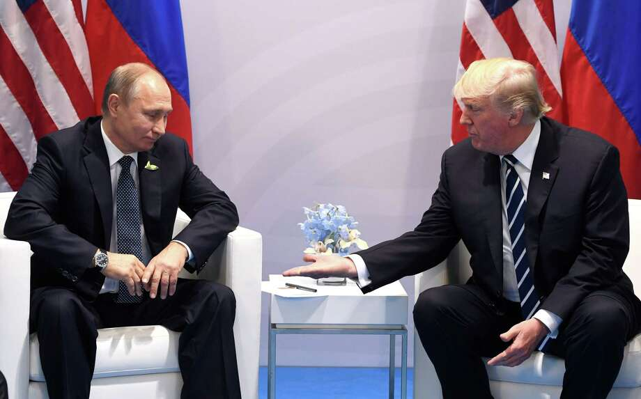 The fact that someone in the White House leaked a briefing memo that asked the president not to congratulate Russia's Putin for winning a rigged election, could be a sign of panic. Here. Trump and Putin shake hands during a meeting on the sidelines of the G20 Summit in Hamburg, Germany in July. Photo: SAUL LOEB /AFP /Getty Images / AFP or licensors