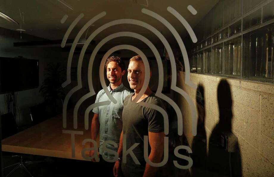 Jaspar Weir, left, and Bryce Maddock, co-founders of TaskUs, which has provided outsourced call center/customer service operations for Uber, Groupon, Tinder, and other big Internet companies, pose for a portrait inside the conference room at their U.S. Headquarters on Aug. 5, 2015 in Santa Monica, Calif. Photo: Mel Melcon /McClatchy-Tribune News Service / Los Angeles Times