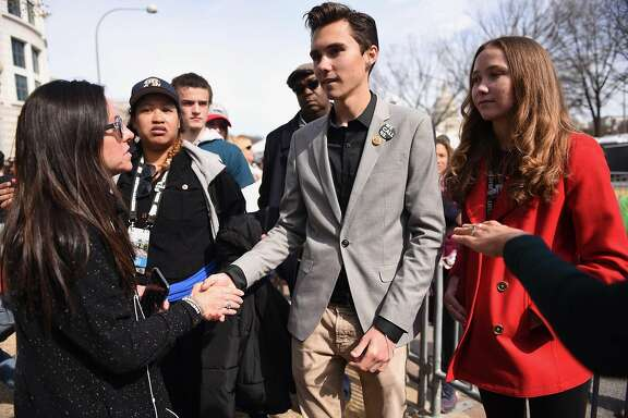Parkland, Fla. student David Hogg, with his 14-year-old sister, Lauren Hogg, next to him, works the crowd of media after the March for Our Lives on Saturday, March 24, 2018 in Washington, D.C. (Debra-Lynn Hook/TNS)