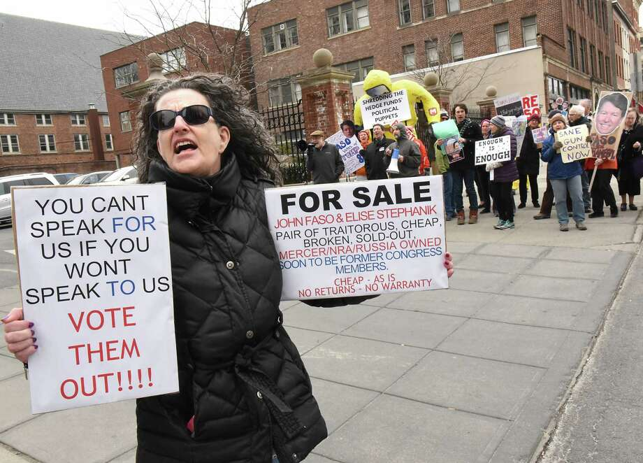 Nancy Eckert of Ravena, left, stands will other protestors outside a fundraiser for John Faso and Elise Stefanik at the Fort Orange Club on Tuesday, March 27, 2018 in Albany, N.Y. (Lori Van Buren/Times Union) Photo: Lori Van Buren, Albany Times Union / 20043308A