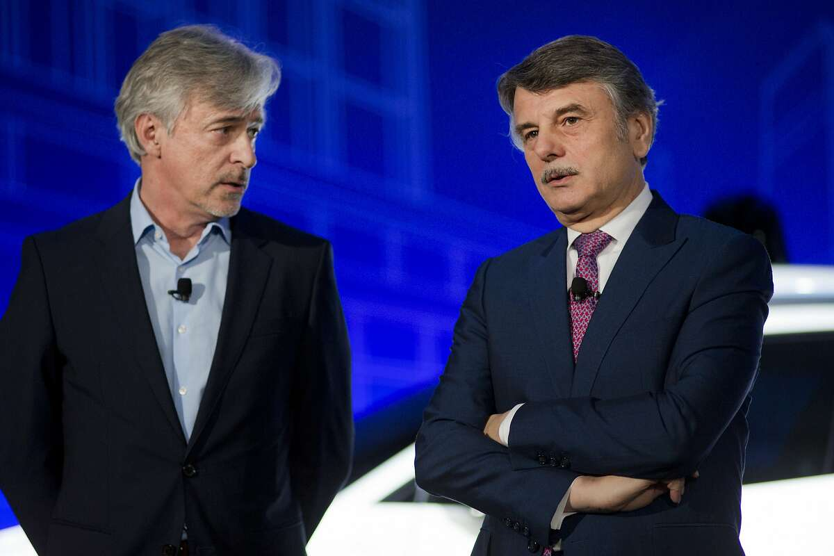 John Krafcik, left, the CEO of Waymo, and Ralph Speth, the CEO of Jaguar, introduce the Jaguar I-Pace vehicle, Tuesday, March 27, 2018, in New York. Self-driving car pioneer Waymo will buy up to 20,000 of the electric vehicles from Jaguar Land Rover to help realize its vision for a robotic ride-hailing service. The commitment announced Tuesday marks another step in Waymo's evolution from a secret project started in Google nine years ago to a spin-off that's gearing up for an audacious attempt to reshape the transportation business. (AP Photo/Mark Lennihan)